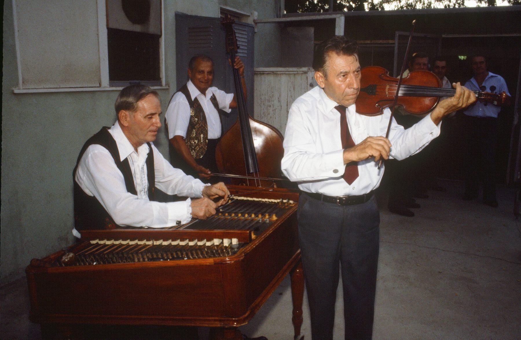 Al Vilagi playing cimbalom with band